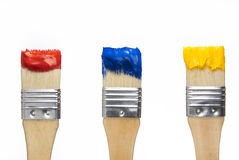 Art-Primary colors. Primary colored brushes isolated on white background. Set of subtractive primary colors, red, blue and white for art education Royalty Free Stock Photography