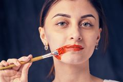 Beautiful woman painted with many vivid colors. Stock Image