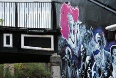 Art publicity beside St Pancras Way Bridge Stock Images