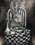 Art rabbit at table eating peas and carrots stock image