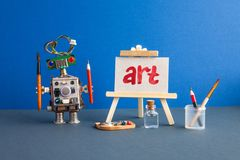 Art and robotic artificial intelligence concept. Robot artist, wooden easel and the handwritten word Art painted red. Watercolor royalty free stock image