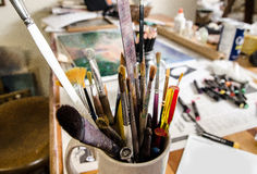 Art school with a colorful collection of brushes Stock Photo