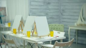 Art school, creativity and concept with easels, brushes and palettes, still life at the studio. 4k stock video