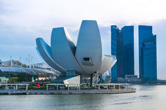 Art Science Museum at Singapore. Singapore's Art Science Museum with the Marina Bay Sands Hotel and it's sky park extending beyond the hotel tower. An awe Stock Photography