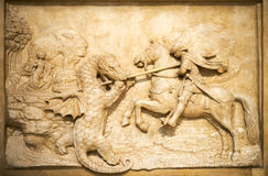Art sculpture knight battle with the dragon Royalty Free Stock Image