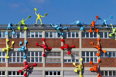 Art sculptures on building. Details of colorful, artistic sculptures on the side of a building.  Dusseldorf, Germany Stock Image