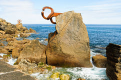 Art and sea. Chillida rusty steel sculpture in San Sebastian Royalty Free Stock Photo