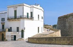 The art and the sea of Otranto. Otranto, Italy - April 11, 2010: Houses of the old town at the side of the Aragonese castle Royalty Free Stock Photos