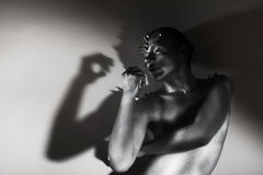Art Silhouette. Silver Painted Man's Body. Shape in Shadows Royalty Free Stock Images