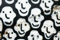 Art Smile Faces en una pared blanca Foto de archivo