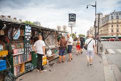Art and souvenir shops with walking people, Paris, France Royalty Free Stock Images