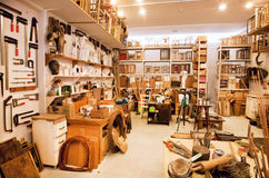 Art space of painters with shelves full of books, brushes and paints in Galerie Stock Image