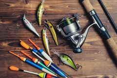 Art sports fishing rod and tackle background royalty free stock photos