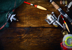 Art sports fishing rod and tackle background Royalty Free Stock Photography