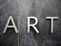 ART stainless steel letters. On stone background Stock Images