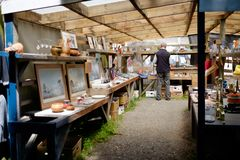 An art stall vendor at Riccarton Sunday Market, Christchurch, New Zealand royalty free stock images