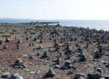 Art of stone balance. Piles of stones on the beach. Costa Adeje in Tenerife, Canary Islands. Spain Stock Photos