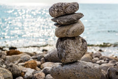Art of stone balance. Piles of stones on the beach. Ibiza, Spain Royalty Free Stock Image
