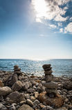 Art of stone balance. Piles of stones on the beach. Ibiza, Spain Stock Image