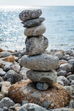 Art of stone balance. Piles of stones on the beach. Ibiza, Spain Royalty Free Stock Photo