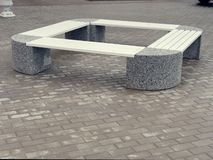 Art stone bench in the historic old town.  royalty free stock photos
