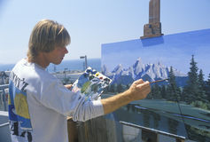 An art student painting a scenic, Stock Photo