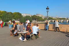 Art students on the Pont des Artes in Paris, France Royalty Free Stock Photos