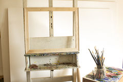 Art Studio with an Easel and Blank Canvases.  royalty free stock photography