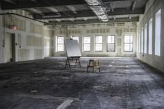 Art studio 6. Large empty industrial art space with an easel and blank canvas Stock Photography