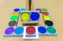 Art studio paints. Art paint palette with paints Stock Image