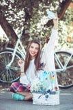 Art stylish hipster woman keep brush outdoor Stock Photos