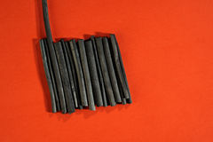 Art supplies: black charcoal sticks. Royalty Free Stock Photo