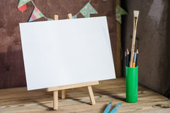 Art supplies. Brushes, easel, paper. Place for your text. Mock up photography. Royalty Free Stock Photography