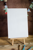 Art supplies. Brushes, easel, paper. Place for your text. Mock up photography. Stock Photo