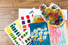 Art supplies for school art, colors mixing, palette and brushes Royalty Free Stock Images