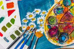 Art supplies for school art, colors, palette and brushes Stock Photos