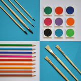 Art supplies on a square cyan and white background. Art supplies with brushes, colored pencils and watercolors on a square cyan and white background Stock Photo