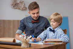 Art teacher and his pupil Royalty Free Stock Image