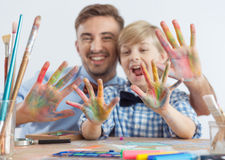 Art teacher and schoolboy. Photo of art teacher and schoolboy with color on hands royalty free stock photos