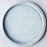 Art texture with free space. Round tray on cement background, texture with free space Stock Photo