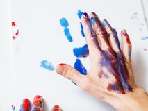 Art therapy hand print recreation painting hobby. Art therapy class school. Man hand closeup. Paint print on white paper. Recreation relaxation painting. Hobby royalty free stock images