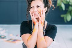 Art therapy happy lady face hands colorful paint royalty free stock photography