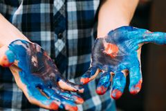 Art therapy hobby inspiration master class. Art therapy. Creative hobby and inspiration. Professional master class. Closeup of male hands dirty with paint royalty free stock image