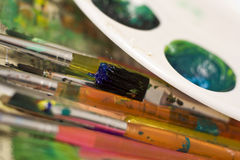 Art Tools. Group of paint brushes and paints Royalty Free Stock Photography