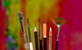 Adult Art Class. A variety of brushes and pencil used in art class Royalty Free Stock Photos