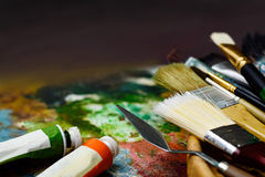 Art tools in the basket with 2 color tubes on the palette Royalty Free Stock Photos