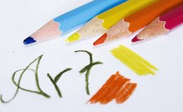 Art tools. Colored pencils with an art text Stock Image
