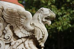 Powerful.  Lion With Wings Topical Local Art. Art. Local Traditional style Lion Marble Carving Decorated In The Garden Corfu Island Greece stock photography