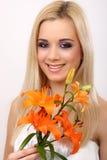 Art und Weisefrau mit Blume Stockfoto