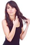 Art und Weisemädchen, das einen Duft verwendet lizenzfreies stockbild